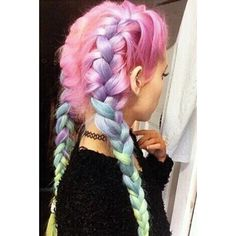 Love the rainbow braids in her pink hair.