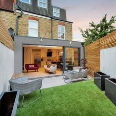 A stunning wraparound extension in Tooting. This Victorian terrace house has been extended to the side and rear, which has delivered a beautiful open plan kitchen, living and dining space. Flat Roof Design, House Extension Design, Roof Extension, Glass Extension, Wraparound Extension, Single Storey Extension, Garden Room Extensions, House Extensions, Kitchen Extensions