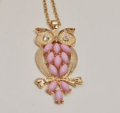 ANA25648:              Quilted like Pink Owl alloy Pendant with goldish chain.  About the picture: There may be a slight difference of color between the picture and the actual ring because of brightness. $9.00