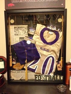 I made this shadow box for my boyfriend for a Christmas present with all of his old high school football keepsakes. The shadow box, letters, and football sign was all 50% off at Hobby Lobby. I ended up spending around 65 dollars on everything.
