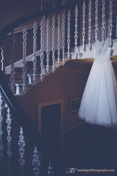 Photograph of the wedding dress hung in the Dryburgh Abbey Hotel staircase Wedding Photo Gallery, Storytelling, Destination Wedding, Wedding Photography, Wedding Dresses, Bride Dresses, Bridal Gowns, Destination Weddings