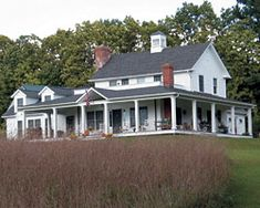 Full front porch remodel on saltbox style home designed for Saltbox house plans with porch