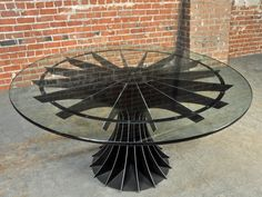 What was once an industrial compressor has been reinvented as a glass-topped table perfect for gathering friends and family around.  Courtesy of Vintage Industrial and Retro.net at https://www.retro.net/shop/compressor-conference-table/