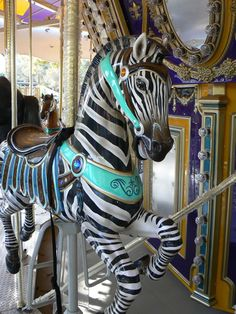 Outer Ring Zebra/Trojan on the carousel at the Happy Hollow Park and Zoo, San Jose, CA