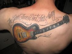 Guitar tattoo with quotes on the back. Simple yet one of the more popular designs as anyone can add just about any quote they desire on the guitar tattoo.