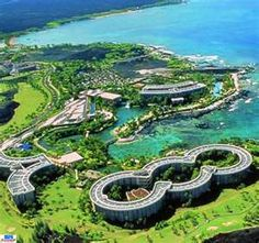 Hilton Waikoloa Village in Kona Hawaii..Showing is Ocean Tower (3 circles)...Palace Tower (Y Shape) and Lagoon Tower (semi circle) with the lagoons and pools, boat canals etc and golf course.