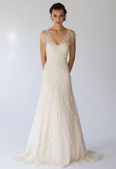 Personally, I'm in love with the delicate details of this dress, especially the light sleeves that top the shoulders.