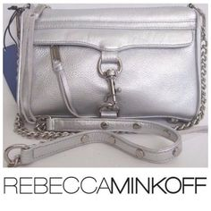 """Rebecca Minkoff Mini Mac Silver Leather NWT Beautiful brand new Mini Mac by Rebecca Minkoff. The colors in my photos look kinda gold but this is definitely a silver metallic leather. Accented with shiny silver hardware. Removable chain and leather strap with a 22"""" drop. One outside zip pocket with flap and hook closure. Top zipper. Protective metal feet. Cotton lined interior with one zip pocket. Super soft leather! Measures approximately 9""""x6.5""""x2"""". Rebecca Minkoff Bags Mini Bags"""