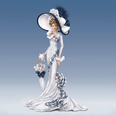 "Inspired by the title character in the film ""My Fair Lady"" comes ""Afternoon At Ascot"", master craftsmen individually sculpt this figurine to display glamorous details. Then talented artisans hand-paint each figurine, adding a glossy finish to the sculpted ribbon to give the appearance of shiny satin. Her hat is graced with genuine feather plumes and a dazzling faux gem that makes her ensemble as memorable as the gown from the movie that inspired it."