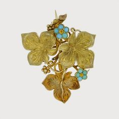 Early Victorian Gold & Turquoise Floral Suite c. 1837-46. Necklace, brooch & earrings set throughout w/cabochon turquoise forget-me-not flowers amongst textured gold vine leaves. Necklace, 3 graduated sections vine leaves, 5 forget-me-not flowers to open fancy link chain measuring 17.5''. Brooch 3 vine leaves, 2 forget-me-not flowers on vertical brooch pin fitting & vine leaf drop earrings w/6 forget-me-not flowers surmounted by a vine leaf tops, gr.wt 56.9 grams; round fitted box.