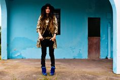 Madame de Rosa:Animal print coat, jeans and blue sneackers