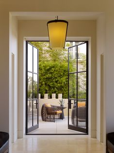 unique steel doors modern lamp lighting outdoor area seating steel and glass door light colored wall of Cool Doors to Peek at If You Want to Have Unique Steel Doors