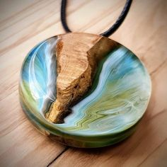 This unique pendant made from dried olive naturally resistant to rays . - This unique pendant made from dried olive naturally resistant to rays … Le maquillage est un proc - Wooden Jewelry, Resin Jewelry, Jewelry Crafts, Diy Resin Crafts, Stick Crafts, Epoxy Resin Wood, Resin Pendant, Schmuck Design, Artisanal