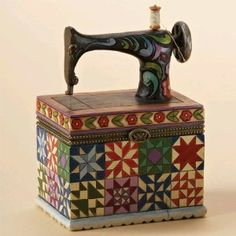 Jim Shore sewing machine hinged box.  I will have to look for this.  I like Jim Shore things.