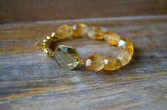 Faceted Citrine Bracelet with Citrine connector and Gold Pyrite,Hamsa on Etsy, $205.00