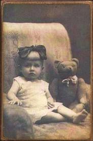 ♥ A Little Girl and her Teddy Bear.
