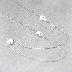 Silver Long Necklace with three skulls by laonato on Etsy, $20.00