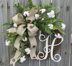 This wreath is the perfect accent for a front door or interior space all year long! A wired faux burlap with wooden buttons creates an informal