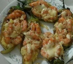 Chiles Rellenos Shrimp with melted cheese ingredients: 6 Chiles poblanos roasted, Clean and deveined 1 kg. Clean Shrimp 1 large onion, chopped 4 cloves Garlic, minced Chihuahua cheese or mozarella Oil or butter salt and pepper to taste procedure: Cook shrimp with garlic and onion and butter salt and pepper and fill the peppers and put cheese on top Enjoy