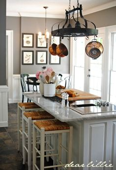 Wall Color: Benjamin Moore's Chelsea Gray Trim Color/Cabinet Color: Benjamin Moore's Simply White - considering this type of gray wall in the kitchen with white cabinets.