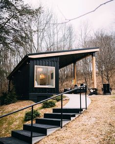 Nestled on 13 acres of woods, this adorable shipping container is inspiring. Dubbed The Lilypad and located a couple miles from the entrance of Old Man's Cave in Logan, Ohio, we love its black facade and cozy interior. Let's take a look! Tiny House Cabin, Tiny House Living, Tiny House Plans, My House, Tiny Guest House, Shed To Tiny House, Tiny House Exterior, Build Your House, Guest Houses