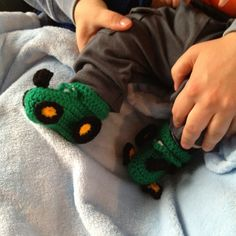 My crocheted tractor slippers on my nephew