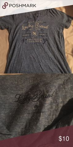 Lucky Brand short sleeve shirt Excellent condition! Lucky Brand women's size medium short sleeve top. I did not cut the top, it came like that.  Bundle and save in my closet! Lucky Brand Tops Tees - Short Sleeve