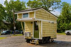 This is the Hardy Tiny House by Wishbone Tiny Homes. It's an 8′ x 12′ tiny cabin on a trailer. From the outside, you'll notice how the loft overhangs above the front door. W…