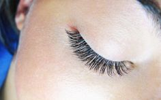 Close up of 1:1 application of silk eyelash extensions.