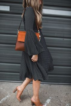 Polka dot dress with bell sleeves.