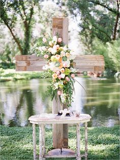 rustic cross ceremony backdrop