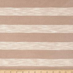 Stripe Sweater Knit Sand from @fabricdotcom  This sweater knit fabric has an ultra soft hand, fluid drape and a 20% four-way mechanical stretch. It has an open knit technique, making it semi-sheer. It is perfect for sheer cardigans, layering sweaters, scarves and wraps. It features yarn dyed horizontal stripes.