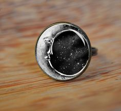 Hey, I found this really awesome Etsy listing at https://www.etsy.com/listing/163153869/moon-face-ring-domed-glass-ring-picture