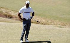 Spieth and Reed share Open lead, Woods misses cut