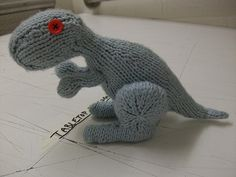 Free knitting pattern for  Dino the Dinosaur Designed by Alyssa Lynough, Dino is a friendly little dinosaur, whose construction is a bit tricky for beginners but a fun challenge for the more advanced toy makers among us.