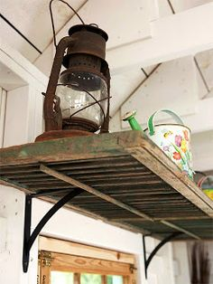 Use old shutters for shelves in potting shed. Shutter shelf via BHG Old Window Shutters, Repurposed Shutters, Vintage Shutters, Old Shutters Decor, Metal Shutters, Bedroom Shutters, White Shutters, Window Frames, White Walls