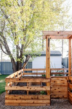 This DIY Enclosed garden not only looks beautiful, but it does a great job of keeping animals out of your garden beds. A perfect weekend project, you won't believe how simple and inexpensive building your own fenced raised garden bed can be! #DIYraisedgarden #enclosedgarden #enclosedraisedgarden #fencedraisedgarden #fencedgarden #howtobuildagarden