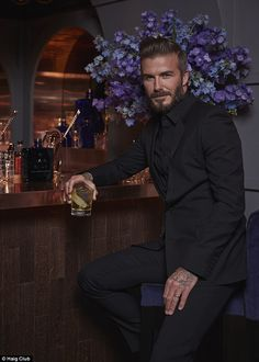 David Beckham is joined by wife Victoria as he opens pop-up Haig Bar #dailymail