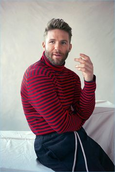 Sporting a striped Gucci sweater, Julian Edelman also wears Rick Owens drawstring trousers.
