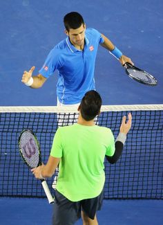 MELBOURNE, AUSTRALIA - JANUARY 28: Novak Djokovic of Serbia is congratulated by Milos Raonic of Canada after winning their quarter final match during day 10 of the 2015 Australian Open at Melbourne Park on January 28, 2015 in Melbourne, Australia. (Photo by Scott Barbour/Getty Images)