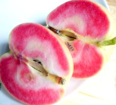 Pink Pearl Apple: Developed in 1944 by Albert Etter in northern California, they have a translucent, yellow-green skin and a pink,crisp, juicy flesh with tart to sweet-tart taste. via wikipedia http://tinyurl.com/3ey8s6b Photo via mcevoyranch #Fruit #Pink_Pearl_Apple