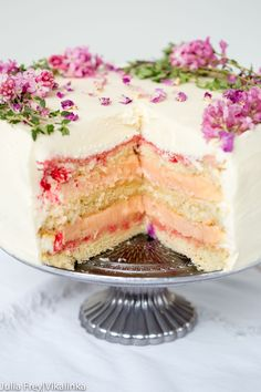 Delicate vanilla bean flavoured sponge layered with rhubarb curd and frosted with rose water and vanilla mascarpone. This cake is what dreams are made of!