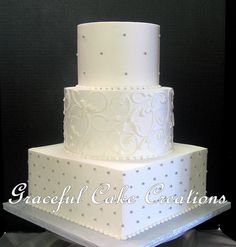https://flic.kr/p/GxJRfN | Elegant White Butter Cream Wedding Cake with Silver Accents