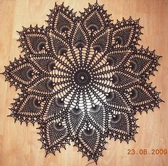 Pineapple Doily Pattern #7275 from Spool Cotton #147, Doilies measures about 14 inches in diameter.