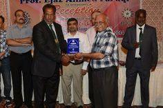 Mr. Musheer Rabbani Treasure KCCA giving Shield to Muhammad Nizam