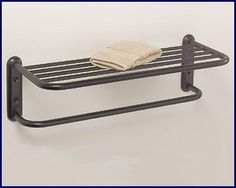 """Oil Rubbed Bronze Hotel Towel Shelf or Train Rack with Bar by YouRemodel. $79.99. Bronze towel rack in the Hotel Spa or Train Rack style with towel rod.  Perfect for your bathroom, pool area, or laundry room.  All metal with a Burnished Bronze finish. **  This type of Bronze finish is a dark brown color with speckled copper highlights showing through.  Overall measurements 21 1/2"""" wide and 6 1/2"""" high.  Shelf is 20 1/2"""" wide.  Projects out from the wall 9"""" .  ..."""