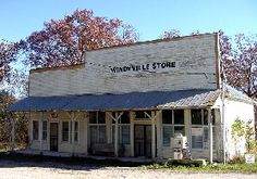 The Sadness of Old Buildings by Gary E. Anderson Abandoned store and gas station in Windyville,  Missouri