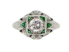 Diamond and calibré emerald ring, circa 1950. from Berganza London Hatton Garden