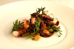 The charred baby octopus caponata located at Sage inside ARIA Resort & Casino