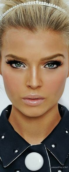 Eyes are accentuated in this look using eyeliner, lashes and highlighter on inner eye. Brows are a gorgeous brown to complement her blonde hair. Blush applied on apples of cheek to give soft pink glow and nude yet slightly iridescent lip finishes the look beautifully.-ShazB Pin by LoLo